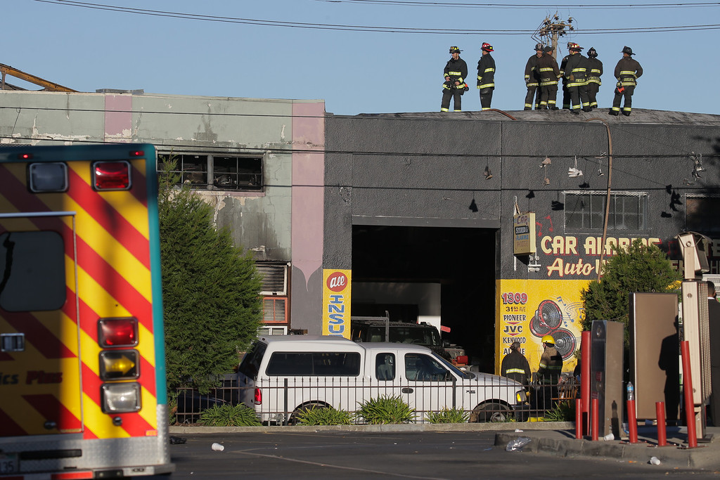 . OAKLAND, CA - DECEMBER 03:  Firefighters investigate the scene of a overnight fire that claimed the lives of at least nine people at a warehouse in the Fruitvale neighborhood on December 3, 2016 in Oakland, California. The warehouse was hosting an electronic music party.  (Photo by Elijah Nouvelage/Getty Images)