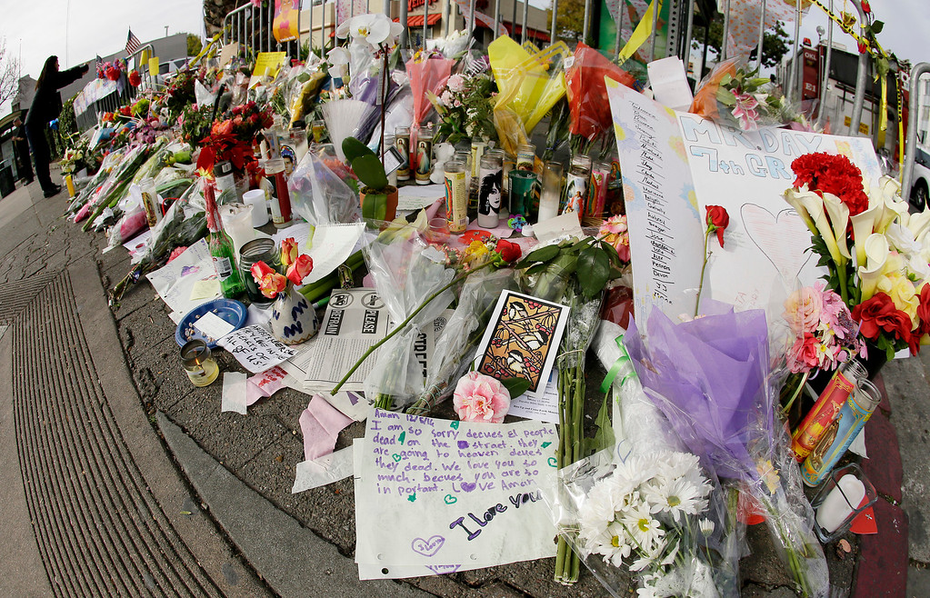 . Flowers and notes are left at a makeshift memorial near the site of a warehouse fire Wednesday, Dec. 7, 2016, in Oakland, Calif. Recovery efforts at the site have ended officials said Wednesday.  (AP Photo/Eric Risberg)