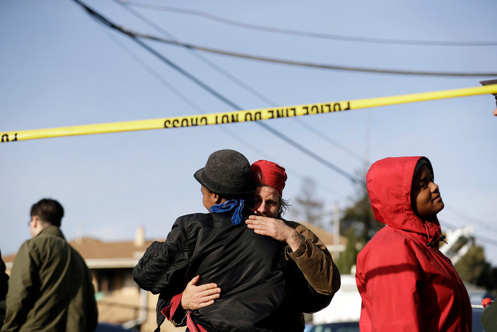 . People embrace at the scene of a warehouse fire Sunday, Dec. 4, 2016, in Oakland, Calif. Officials in Oakland say the dozens of people confirmed dead in a fire at a warehouse range in age from teenagers to 30-plus years old.  (AP Photo/Marcio Jose Sanchez)