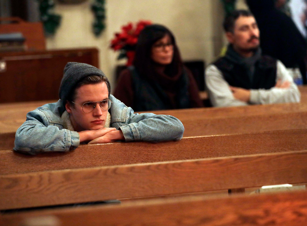 . Nathan Wheeler, at left, attends a memorial for victims of a warehouse fire at Chapel of the Chimes Saturday, Dec. 3, 2016, in Oakland, Calif. Wheeler has a friend who attended the party at the warehouse and is missing. Firefighters struggled to get to bodies in the rubble Saturday after a fire tore through a converted Oakland warehouse during a late-night electronic music party. (AP Photo/Marcio Jose Sanchez)