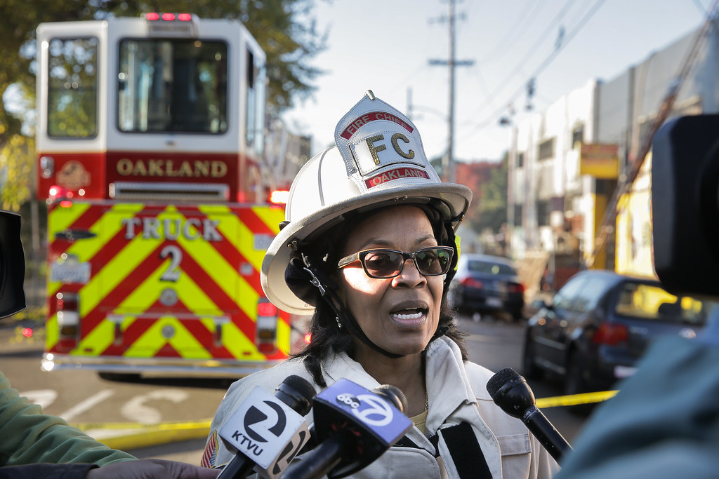 . OAKLAND, CA - DECEMBER 03:  Oakland Fire Chief Teresa Deloach Reed speaks to the press following an overnight fire that claimed the lives of at least nine people at a warehouse in the Fruitvale neighborhood on December 3, 2016 in Oakland, California. The warehouse was hosting an electronic music party.  (Photo by Elijah Nouvelage/Getty Images)