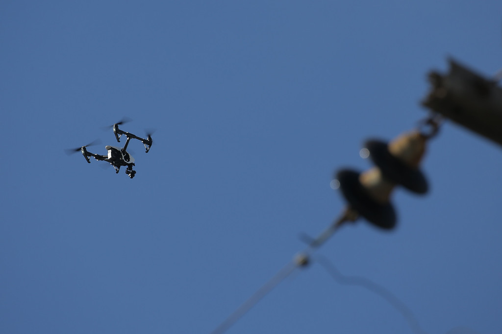 . OAKLAND, CA - DECEMBER 03: A drone is used to provide emergency responders with an aerial view of a warehouse following an overnight fire that claimed the lives of at least nine people at a warehouse in the Fruitvale neighborhood on December 3, 2016 in Oakland, California. The warehouse was hosting an electronic music party.  (Photo by Elijah Nouvelage/Getty Imag