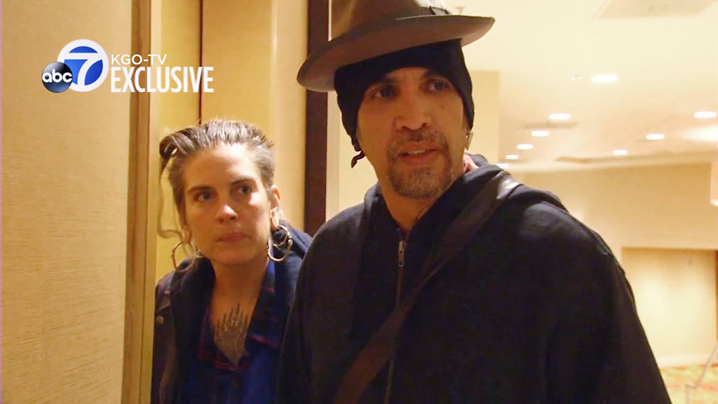 """. This still frame from exclusive video provided by San Francisco TV station KGO-TV, made late Sunday, Dec. 4, 2016, shows Derick Ion Almena, right, and Micah Allison, the couple who operated the Ghost Ship warehouse where dozens have died in a fire, at the Oakland, Calif., Marriott Hotel. When a KGO reporter asked if he had anything to say to the families of those who were killed, Almena said: \""""They\'re my children. They\'re my friends, they\'re my family, they\'re my loves, they\'re my future. What else do I have to say?\"""" (KGO-TV via AP)"""