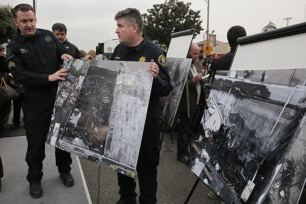 . OAKLAND, CA - DECEMBER 05: Law enforcement officers describe obstacles and progress related to the recovery efford for victims of a warehouse fire that has claimed the lives of at least thirty-six people on December 5, 2016 in Oakland, California. The fire took place during a musical event late Friday night. (Photo by Elijah Nouvelage/Getty Images)