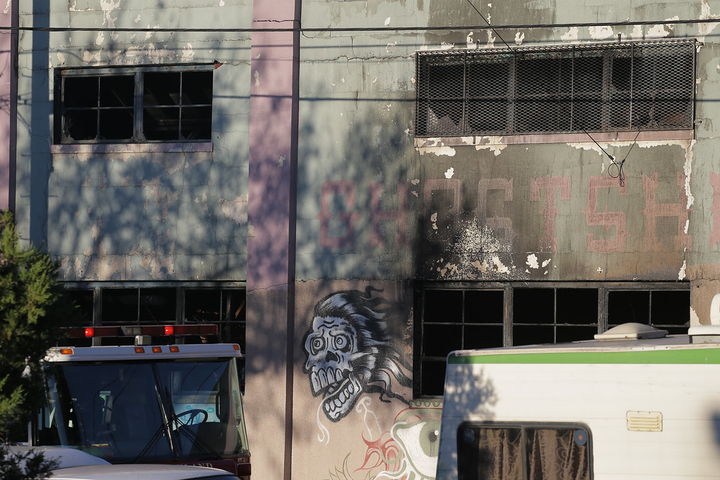 . OAKLAND, CA - DECEMBER 03:  Charred windows on the face of a building that was the scene of a overnight fire that claimed the lives of at least nine people at a warehouse in the Fruitvale neighborhood on December 3, 2016 in Oakland, California. The warehouse was hosting an electronic music party.  (Photo by Elijah Nouvelage/Getty Images)