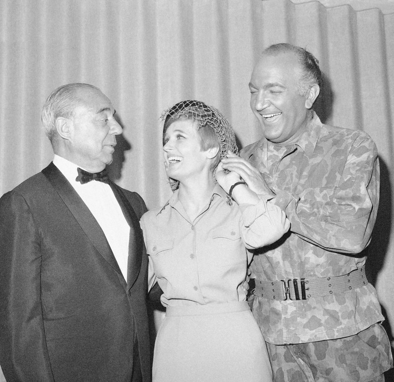 ". FILE - In this June 12, 1967 file photo, composer Richard Rodgers, left, poses at opening night with stars, Florence Henderson, center, and Giorgio Tozzi, of the New York revival of ""South Pacific,\"" which Rodgers and Oscar Hammerstein II wrote. Henderson, the wholesome actress who went from Broadway star to television icon when she became Carol Brady, the ever-cheerful matriarch of \""The Brady Bunch,\"" has died, her manager and her publicist said. She was 82. Henderson died Thursday night, Nov. 24, 2016, at Cedars-Sinai Medical Center in Los Angeles, after being hospitalized the day before, said her publicist, David Brokaw. (AP Photo/John Lindsay, File)"