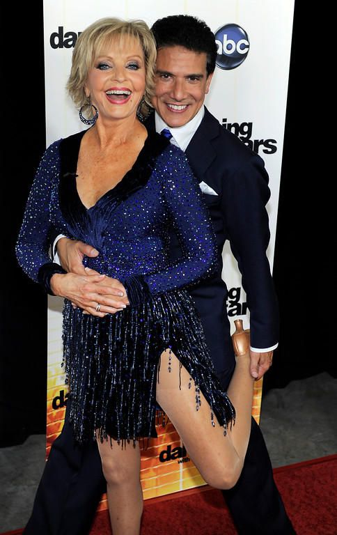". Contestant Florence Henderson poses with her dance partner Corky Ballas at the 11th season premiere of ""Dancing with the Stars,\"" Monday, Sept. 20, 2010. (AP Photo/Chris Pizzello)"