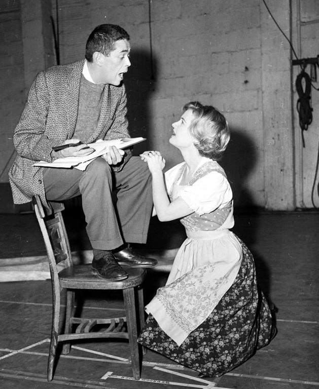 ". With an assist from director Vincent Donahue, star Florence Henderson rehearses a song for ""The Sound of Music.\"" Feb. 9, 1961.  She heads the national company which will open a cross country tour Feb. 27, 1961 in Detroit. Accent in the New York reheasals of the show has been on building the road show on its own, not copying the original execpt for costumes and scenery. (AP Photo)"