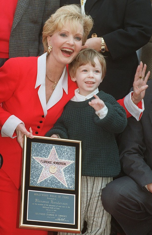". Actress Florence Henderson celebrates receiving the 2,061st star on the Hollywood Walk of Fame with her grandson Kyle Russell, 2, Wednesday, Feb. 14, 1996, in the Hollywood section of Los Angeles. Henderson, well-known for her role as Carol Brady on television\'s ""The Brady Bunch,\"" also celebrated her birthday on Wednesday. (AP Photo/Chris Pizzello)"