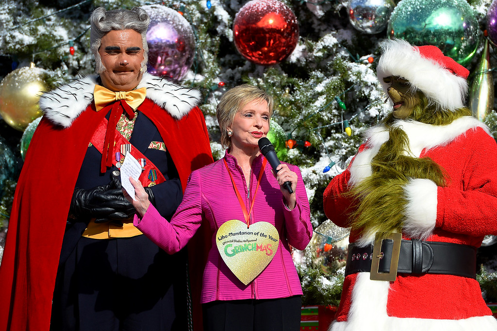 ". Actress Florence Henderson thanks the Grinch for her ""Who-Manitarian of the Year\"" award for behalf of her work with the City of Hope as Universal Studios Hollywood kicks off \'Grinchmas Wholidays,\' Wednesday, November 27, 2013. (Photo by Michael Owen Baker/L.A. Daily News)"