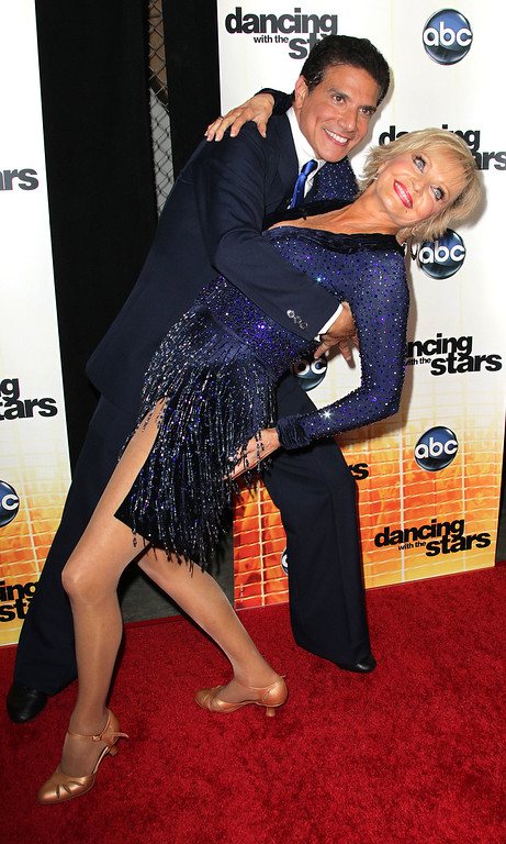 ". LOS ANGELES, CA - SEPTEMBER 20:  Dancers Corky Ballas (L) and Florence Henderson attend the premiere of ""Dancing With The Stars\"" at CBS Television City on September 20, 2010 in Los Angeles, California.  (Photo by Frederick M. Brown/Getty Images)"