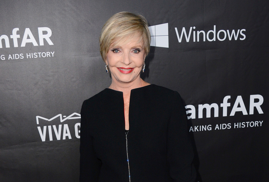 ". FILE - In this Oct. 29, 2014 file photo, Florence Henderson arrives at the 2014 amfAR Inspiration Gala at Milk Studios in Los Angeles. Henderson, the wholesome actress who went from Broadway star to television icon when she became Carol Brady, the ever-cheerful mom residing over ""The Brady Bunch,\"" has died at age 82. She died surrounded by family and friends, her manager, Kayla Pressman, said in a statement late Thursday, Nov. 24, 2016. (Photo by Jordan Strauss/Invision/AP, File)"