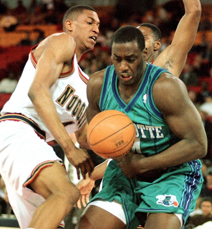 . FILE - Charlotte Hornets Anthony Mason (R) and Denver Nuggets Tony Battie (L) struggle for the ball during the first period of their NBA game 23 February at McNichols Sports Arena in Denver, CO.  (DOUG COLLIER/AFP/Getty Images)
