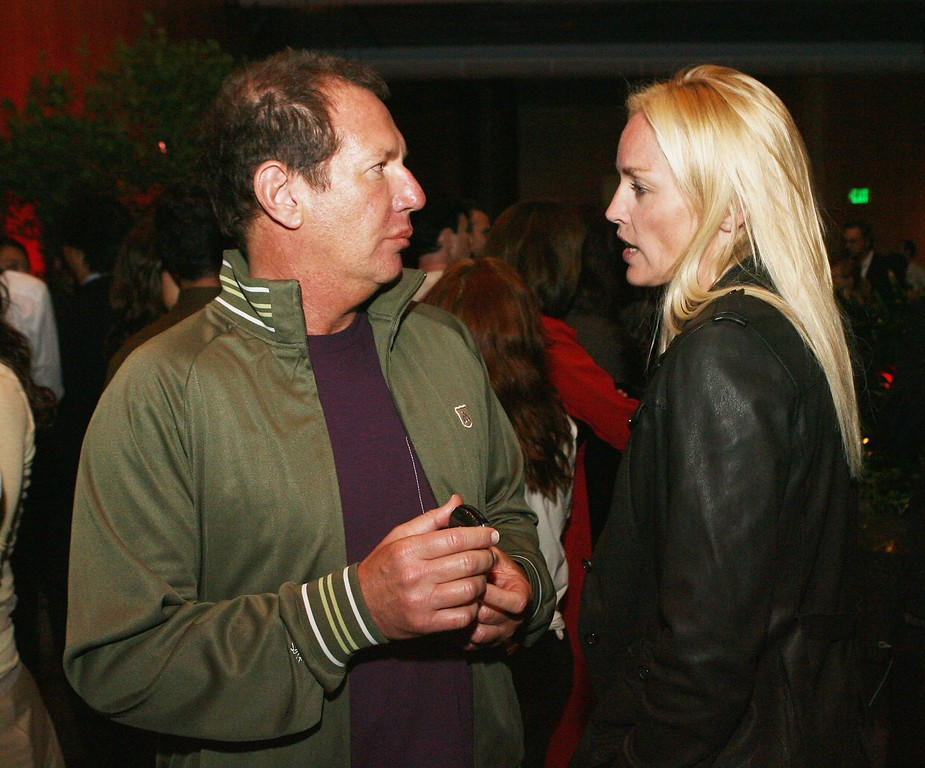 """. Actors Garry Shandling (L) and Sharon Stone talk at the afterparty for the premiere of Paramount Classic\'s \""""An Inconvenient Truth\"""" at the Director\'s Guild of America on May 16, 2006 in Los Angeles, California. (Photo by Kevin Winter/Getty Images)"""