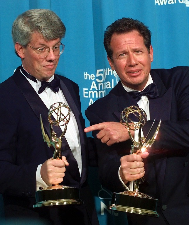 """. FILE - In this Sept. 13, 1998 file photo, writer-producer Peter Tolan, left, and Garry Shandling pose with their Outstanding Writing for a Comedy Series Award for \""""The Larry Sanders Show,\""""  at the 50th Annual Primetime Emmy Awards at the Shrine Auditorium in Los Angeles.  (AP Photo/Victoria Arocho, file)"""