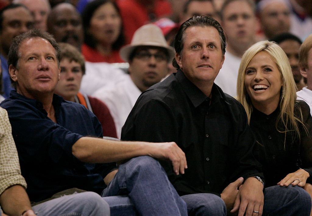 . Comedian Garry Shandling, left, and golfer Phil Mickelson with his wife, Amy, watch the Los Angeles Clippers and Phoenix Suns during Game 3 of an NBA basketball Western Conference semifinal series Friday, May 12, 2006, in Los Angeles. (AP Photo/Kevork Djansezian)