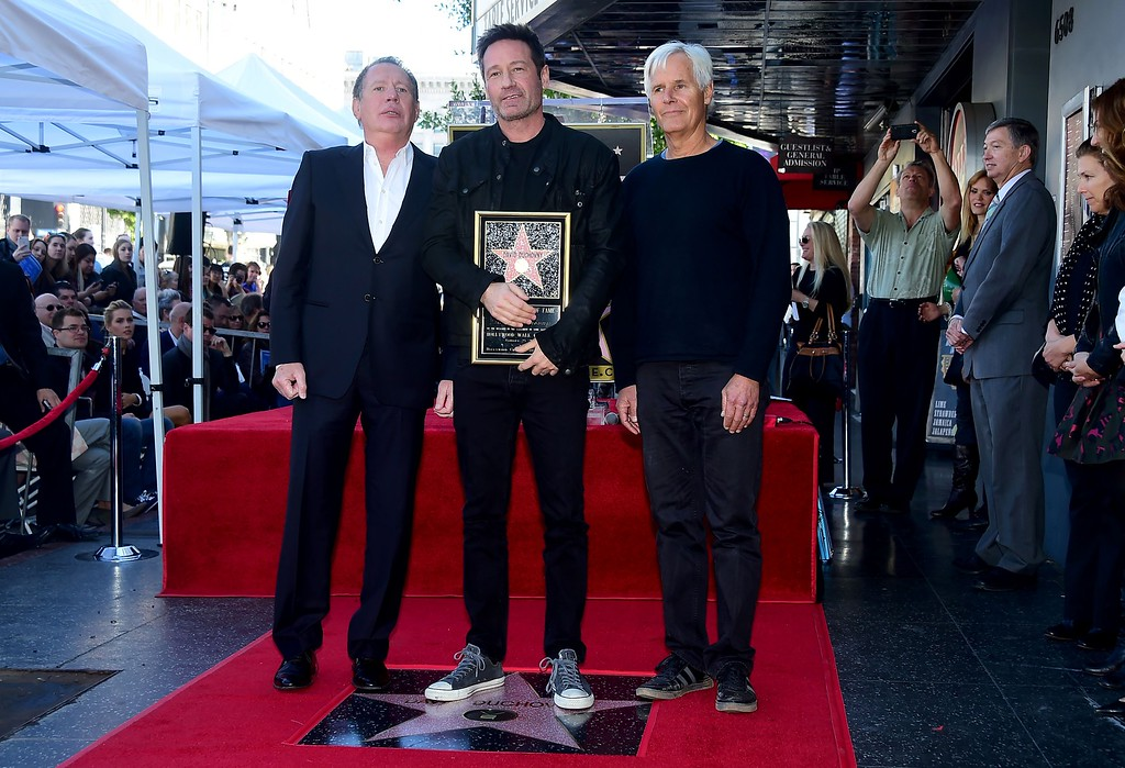 . File - Actor David Duchovny poses on his just unveiled Hollywood Walk of Fame Star with Garry Shandling (L) and Chris Carter (R)on January 25, 2016 in Hollywood, California. (FREDERIC J. BROWN/AFP/Getty Images)
