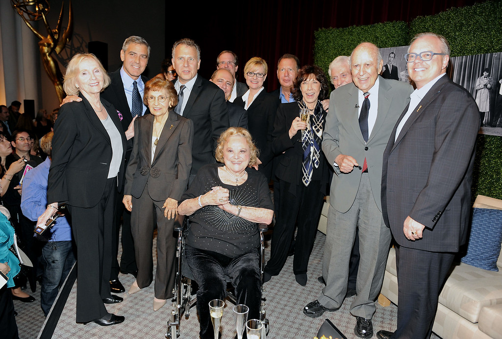 """. (L-R) Actors Eva Marie Saint, George Clooney, ATAS Executive Committee member Rocci Chatfield, actors Paul Reiser, Larry Matthews, moderator Pete Hammond, actors Bonnie Hunt, Garry Shandling, Lily Tomlin, Dick Van Dyke, honoree Carl Reiner, Academy Chairman and CEO John Shaffner and actress Rose Marie (center front) attend the Academy of Television Arts & Sciences Presents: \""""An Evening Honoring Carl Reiner\"""" at the Leonard H. Goldenson Theatre on October 13, 2011 in North Hollywood, California. (Photo by Frank Micelotta/Invision for the Academy of Television Arts & Sciences/AP Images)"""