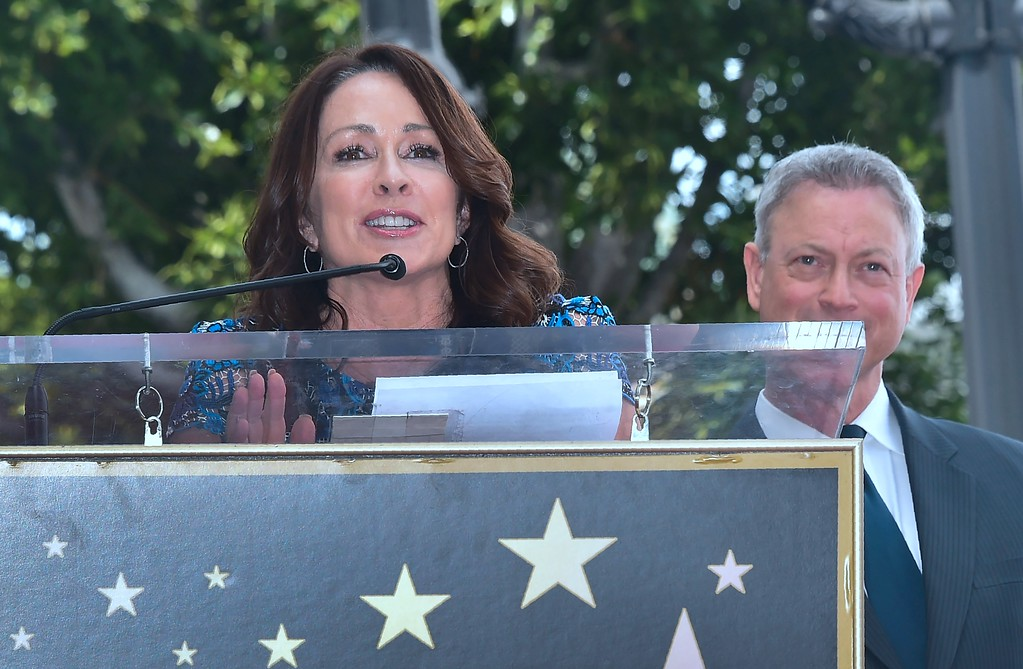 . Actress Patricia Heaton speaks at the Walk of Fame Star ceremony for actor Gary Sinese (R) in Hollywood, California on April 17, 2017. Sinise was the recipient of the 2,606th star on the Walk of Fame.  (FREDERIC J. BROWN/AFP/Getty Images)