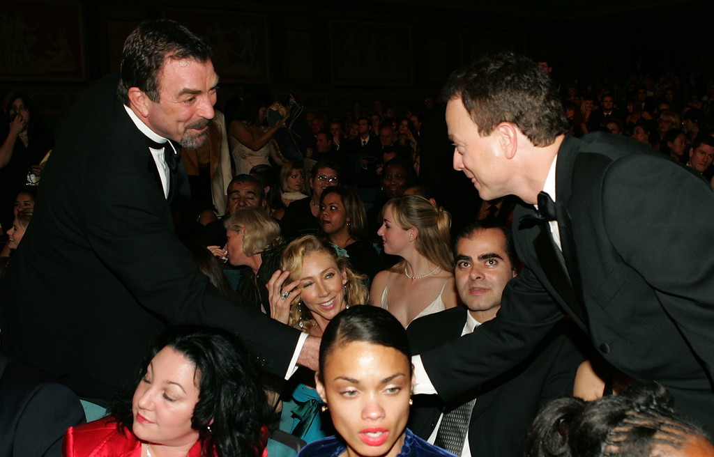 . PASADENA, CA - JANUARY 09:  Actors Tom Selleck (L) and Gary Sinise shake hands in the audience during the 31st Annual People\'s Choice Awards at the Pasadena Civic Auditorium January 9, 2005 in Pasadena, California.  (Photo by Frank Micelotta/Getty Images)