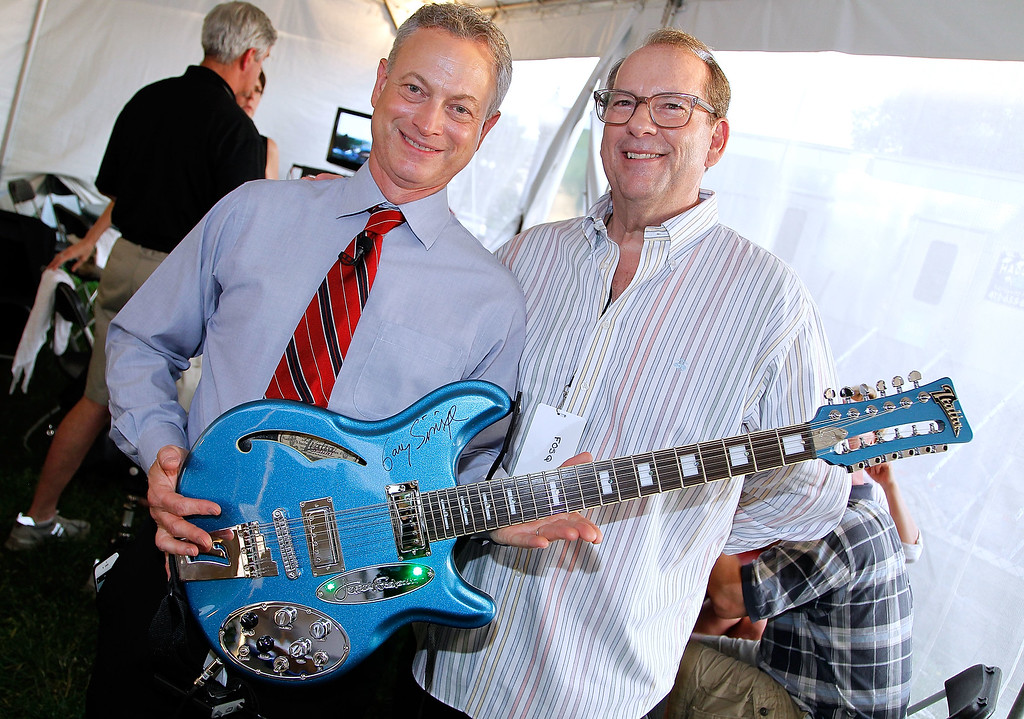 . WASHINGTON, DC - MAY 28:  Actor Gary Sinise (L) and Jeffery Foskett of The Beach Boys pose for a photo with Foskett\'s Italia JF-12 signature guitar backstage at the 27th National Memorial Day Concert Rehearsals on May 28, 2016 in Washington, DC.  The guitar, signed by Memorial Day Concert talent, will be autioned at a later date with the proceeds going to the Gary Sinise Foundation.  (Photo by Paul Morigi/Getty Images for Capitol Concerts)