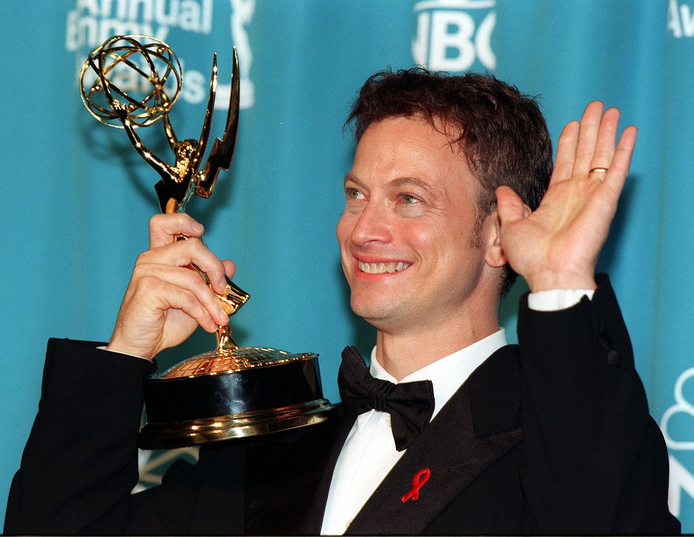". LOS ANGELES, UNITED STATES:  Actor Gary Sinise holds his Emmy Award at the 50th Annual Primetime Emmy Awards in Los Angeles 13 September. Sinise won Outstanding Lead Actor in a Miniseries or Movie for his role as former governor of Alabama and independent presidential candidate George Wallace in ""George Wallace.\""   (LUCY NICHOLSON/AFP/Getty Images)"