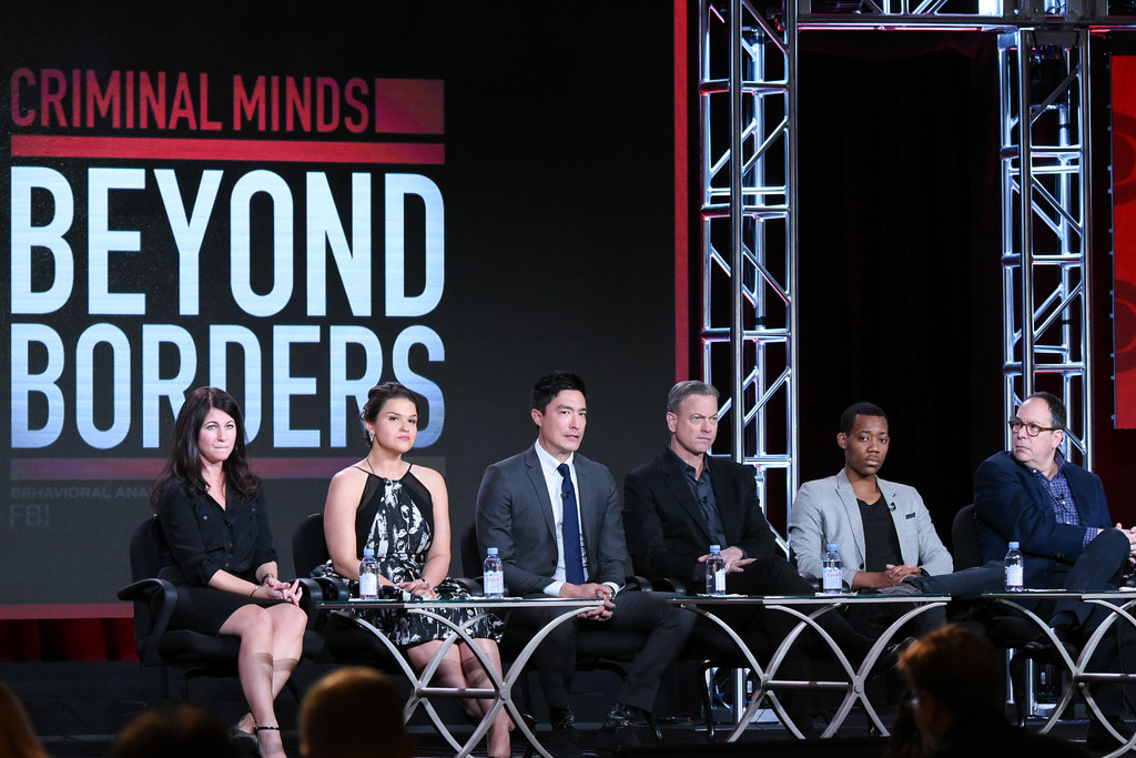 """. Executive producer/creator Erica Messer, from left, actors Annie Funke, Daniel Henney, Gary Sinise, Tyler James Williams and executive producer Mark Gordon participate in the \""""Criminal Minds: Beyond Borders\"""" panel at the CBS 2016 Winter TCA on Tuesday, Jan. 12, 2016, in Pasadena, Calif. (Photo by Richard Shotwell/Invision/AP)"""
