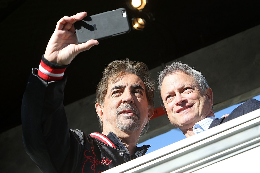 """. WASHINGTON, DC - MAY 23:  Actors and co-hosts Joe Mantegna (L) and Gary Sinise take a \""""selfie\"""" at the 26th National Memorial Day Concert Rehearsals on May 23, 2015 in Washington, DC.  (Photo by Paul Morigi/Getty Images for Capitol Concerts)"""