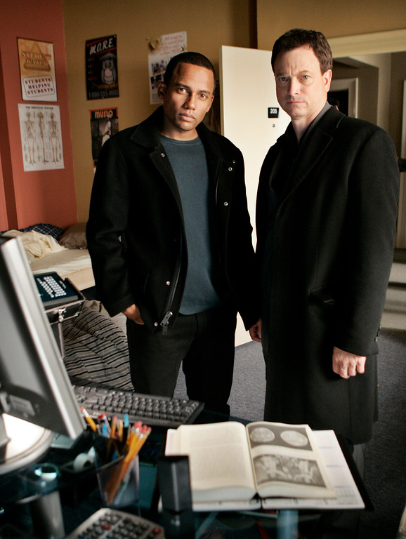 """. Actors Gary Sinise as Det. Mac Taylor, right, and Hill Harper as Dr. Sheldon Hawkes pose on the set of \""""CSI:NY\"""" in Los Angeles Wednesday, Jan. 10, 2007. (AP Photo/Reed Saxon)"""