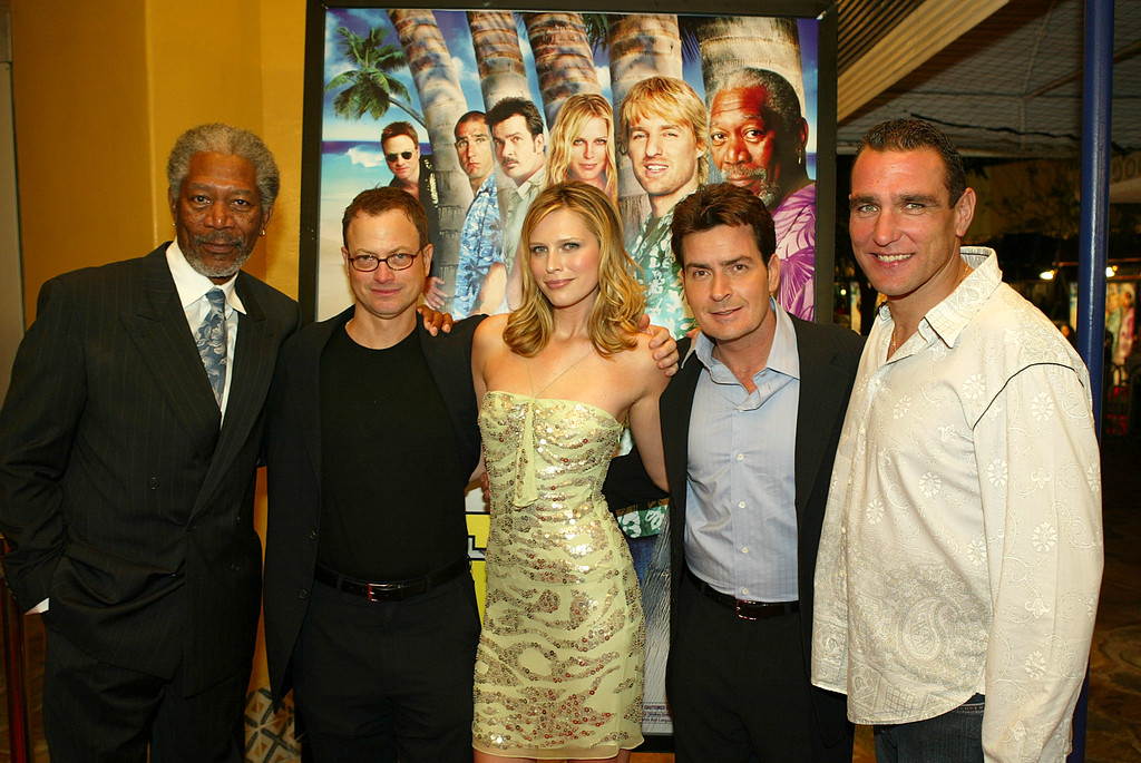 . (L to R) Actors Morgan Freeman, Gary Sinise, Sara Foster, Charlie Sheen and Vinnie Jones pose at the Los Angeles premiere of Warner Bros. \'The Big Bounce\' at the Mann\'s Village on January 29, 2004 in Westwood, California. (Photo by Kevin Winter/Getty Images).