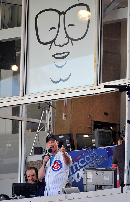 . CHICAGO, IL - JULY 17:  Actor Gary Sinise sings \'Take Me Out to the Ballgame\' during the seventh inning stretch of the Florida Marlins Chicago Cubs game at Wrigley Field on July 17, 2011 in Chicago, Illinois.   (Photo by Brian Kersey/Getty Images)