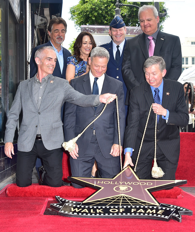 . Actor Gary Sinise(C) reacts at his Walk of Fame Star ceremony in Hollywood, California on April 17, 2017. (FREDERIC J. BROWN/AFP/Getty Images)