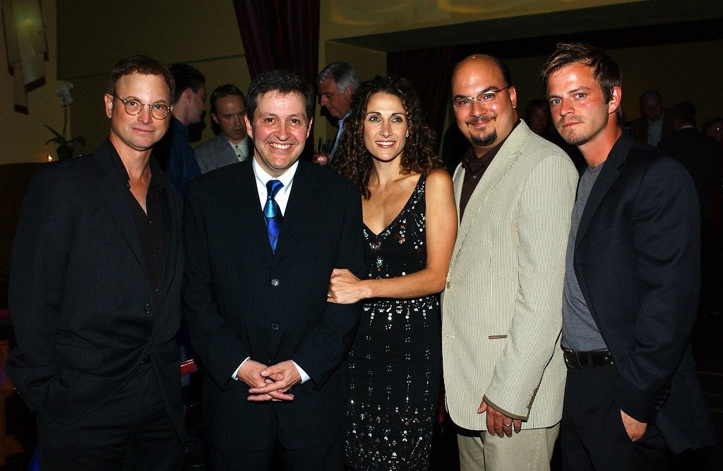 """. BEVERLY HILLS, CA - MAY 24:  (US TABS AND HOLLYWOOD REPORTER OUT)  (L-R) Actor Gary Sinise, Ted Riley, actress Melina Kanakaredes, executive producer Anthony Zuiker and actor Carmine Giovinazzo pose at the \""""CSI: NY\"""" cocktail party on May 24, 2004 at Nic\'s in Beverly Hills, California.  (Photo by Amanda Edwards/Getty Images)"""