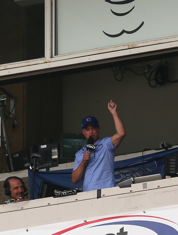 """. CHICAGO, IL - JULY 19: Actor Gary Sinise sings \""""Take Me Out to the Ball Game\"""" during the 7th inning stretch between the Chicago Cubs and the Miami Marlins at Wrigley Field on July 19, 2012 in Chicago, Illinois. The Cubs defeated the Marlins 4-2.(Photo by Jonathan Daniel/Getty Images)"""