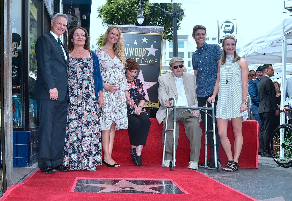 . Actor Gary Sinise poses with his family next to his Star at his Walk of Fame Star ceremony in Hollywood, California on April 17, 2017. Sinise was the recipient of the 2,606th star on the Walk of Fame in the category of television. (FREDERIC J. BROWN/AFP/Getty Images)