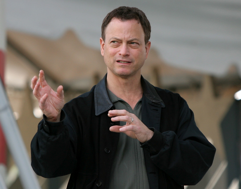 . Actor Gary Sinise gestures during a rehearsal for the 19th Annual PBS National Memorial Day Concert on Capitol Hill in Washington Saturday, May 24, 2008. (AP Photo/Luis M. Alvarez)