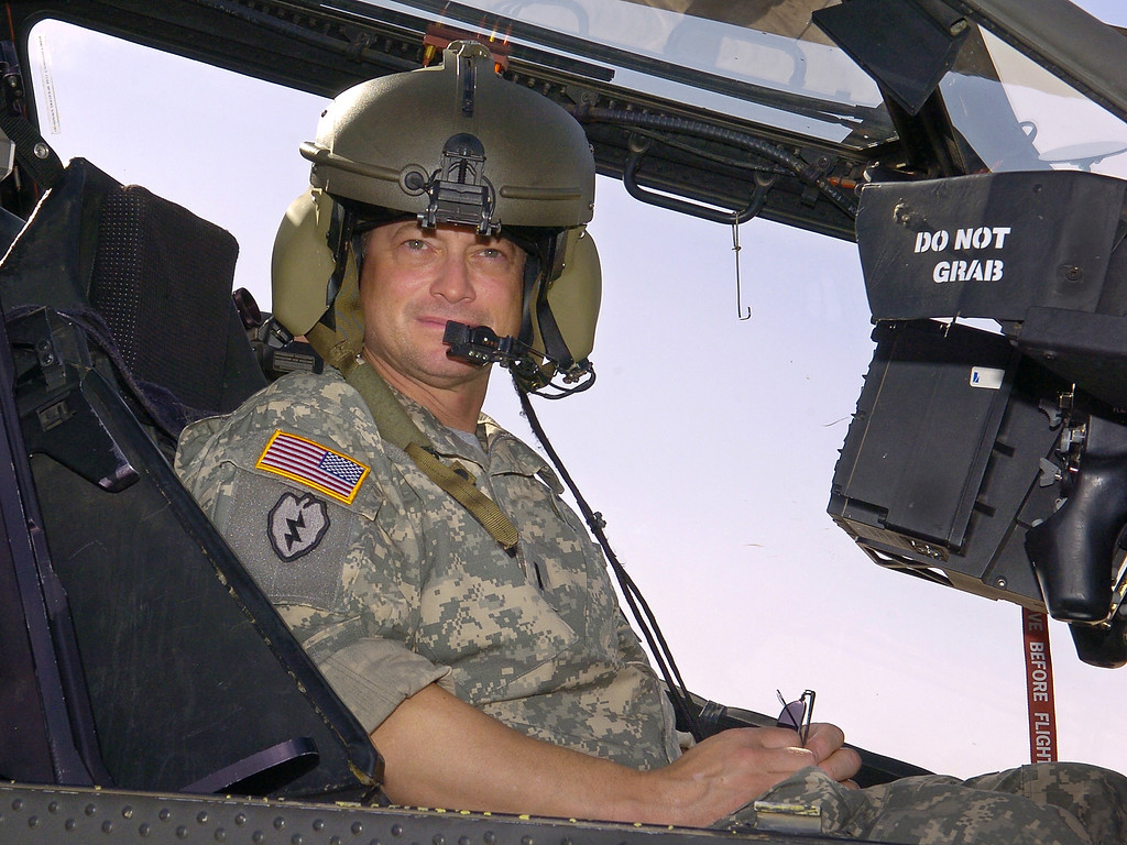 . CONTINGENCY OPERATING BASE, IRAQ - MAY 21:  In this handout provided by the USO, actor Gary Sinise sits in a US Army Apache helicopter during a tour of the flight line May 21, 2007 at Contingency Operating Base Speicher, Iraq. Sinise is on a USO-sponsored meet-and-greet tour to boost morale among US forces in the area.  (Photo by Mike Theiler/USO via Getty Images)