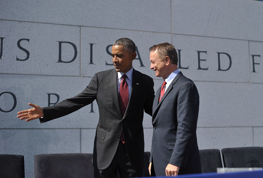 . US President Barack Obama with American Veterans Disabled for Life Memorial spokesman actor Gary Sinise (R) during the dedication of the American Veterans Disabled for Life Memorial on October 5, 2014 in Washington, DC. (MANDEL NGAN/AFP/Getty Images)
