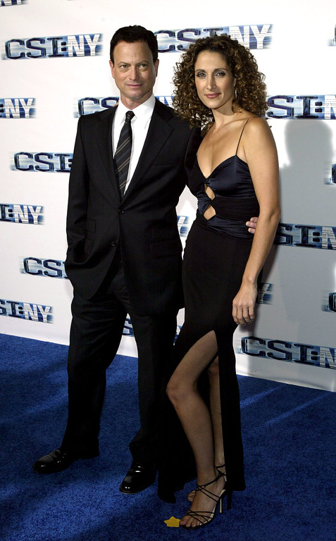 """. NEW YORK - SEPTEMBER 21:  Actors Gary Sinise and Melina Kanakaredes attend the premiere screening of \""""CSI: NY\"""" at the Ed Sullivan Theater September 21, 2004 in New York City.  (Photo by Paul Hawthorne/Getty Images)"""