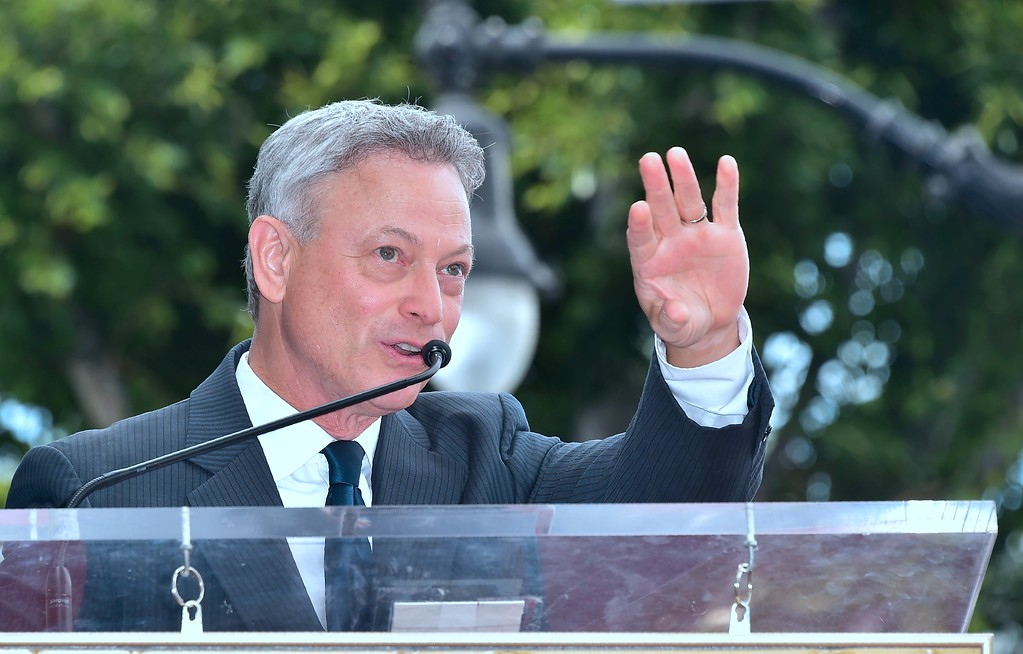 . Actor Gary Sinise waves to fans during his Walk of Fame Star ceremony in Hollywood, California on April 17, 2017.  Sinise was the recipient of the 2,606th star on the Walk of Fame.  (FREDERIC J. BROWN/AFP/Getty Images)