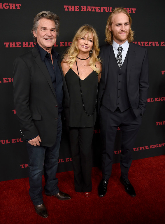 """. Kurt Russell, from left, Goldie Hawn and Wyatt Russell arrive at the Los Angeles premiere of \""""The Hateful Eight\"""" at the Cinerama Dome on Monday, Dec. 7, 2015. (Photo by Chris Pizzello/Invision/AP)"""