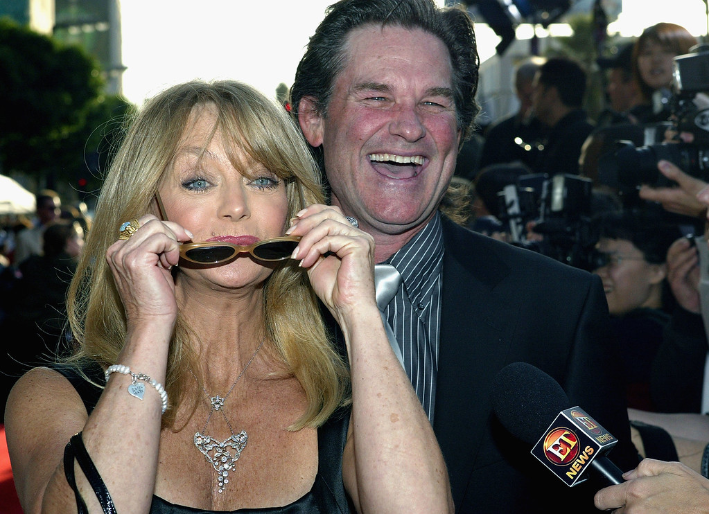 """. HOLLYWOOD - MAY 26:  Actress Goldie Hawn and her partner, actor Kurt Russell, talk to a reporter as they attend the film premiere of the romantic comedy \""""Raising Helen\"""" on May 26, 2004 at the El Capitan Theatre, in Hollywood, California. (Photo by Vince Bucci/Getty Images)"""