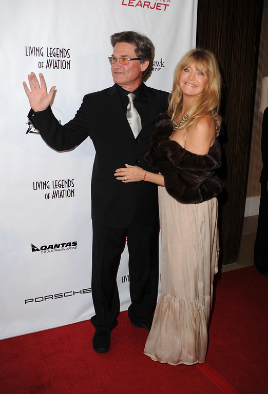 """. BEVERLY HILLS, CA - JANUARY 22:  Actors Kurt Russell and Goldie Hawn arrive at the 7th Annual \""""Living Legends Of Aviation\"""" at The Beverly Hilton Hotel on January 22, 2010 in Beverly Hills, California.  (Photo by Frazer Harrison/Getty Images)"""