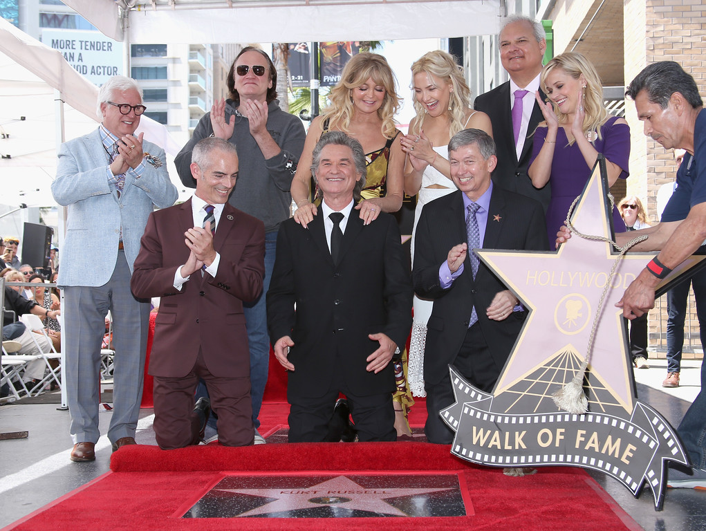 . HOLLYWOOD, CA - MAY 04:  (2nd L-R) Director Quentin Tarantino, Honoree Goldie Hawn and actor Kate Hudson (L-R bottom) Los Angeles Councilmember Mitch O\'Farrell, Honoree Kurt Russell, Hollywood Chamber of Commerce, President/CEO Leron Gubler and actor Reese Witherspoon at Goldie Hawn and Kurt Russell are honored with a Star On the Hollywood Walk of Fame on May 4, 2017 in Hollywood, California.  (Photo by Jesse Grant/Getty Images for Disney)