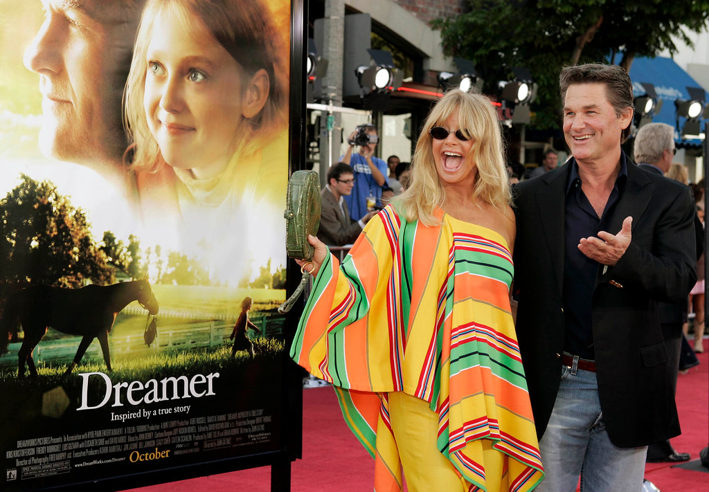 """. Actors Kurt Russell, right, and Goldie Hawn call out to someone they know during the premiere of the film \""""Dreamer\"""" Sunday, Oct. 9, 2005, in Los Angeles. (AP Photo/Ric Francis)"""