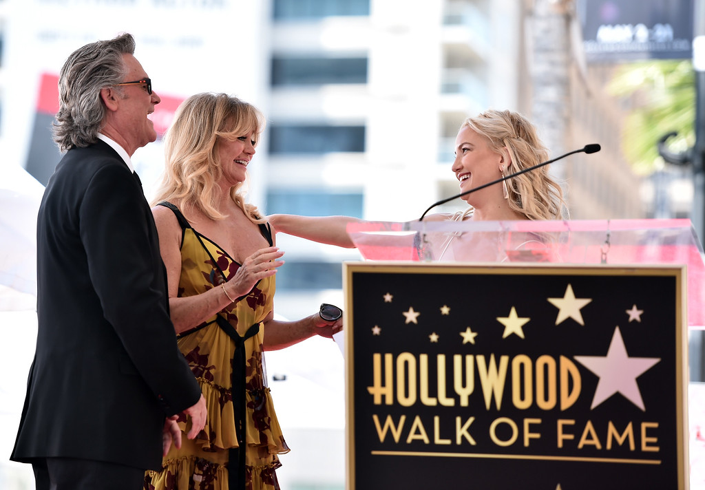 . HOLLYWOOD, CA - MAY 04:  Actors Kate Hudson (R) speaks onstage as Kurt Russell and Goldie Hawn are honored with a double star ceremony on the Hollywood Walk of Fame on May 4, 2017 in Hollywood, California.  (Photo by Alberto E. Rodriguez/Getty Images)