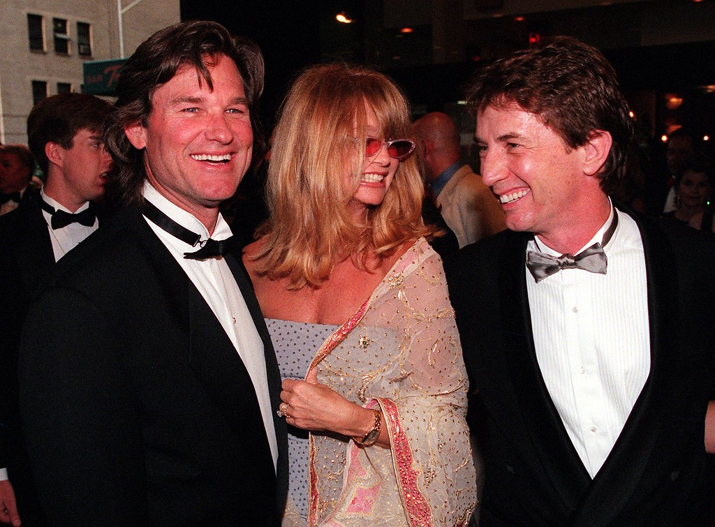 """. Kurt Russell (L), Goldie Hawn (C) and Martin Short (R) arrive to the Tony Awards 06 June 1999 in New York. Short later won the Tony for best actor in a musical for his work in \""""Little Me.\""""    (MATT CAMPBELL/AFP/Getty Images)"""
