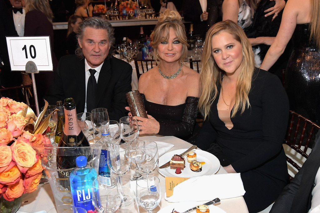 . BEVERLY HILLS, CA - JANUARY 08:  Actors Kurt Russell (L), Goldie Hawn and Amy Schumer at the 74th annual Golden Globe Awards sponsored by FIJI Water at The Beverly Hilton Hotel on January 8, 2017 in Beverly Hills, California.  (Photo by Charley Gallay/Getty Images for FIJI Water)