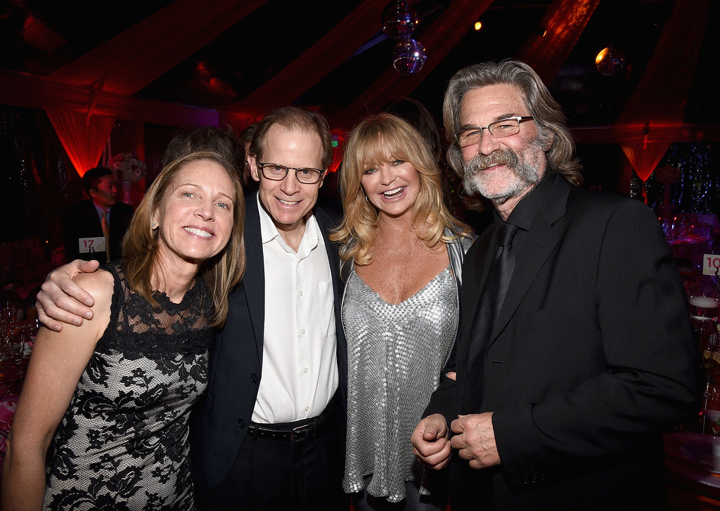""". BEVERLY HILLS, CA - NOVEMBER 21:  (L-R) Caroline Welch Siegel, honoree Dr. Daniel J. Siegel, hosts Goldie Hawn and Kurt Russell attend Goldie Hawn\'s inaugural \""""Love In For Kids\"""" benefiting the Hawn Foundation\'s MindUp program transforming children\'s lives for greater success at Ron Burkle�s Green Acres Estate on November 21, 2014 in Beverly Hills, California.  (Photo by Michael Buckner/Getty Images for The Hawn Foundation)"""
