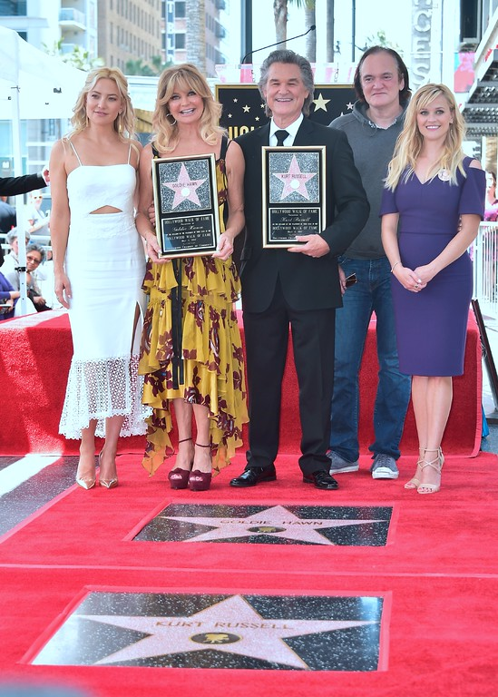 . Kurt Russell and Goldie Hawn pose with Kate Hudson (L), Quentin Tarantino (2nd R) and Reese Witherspoon (R) at their Walk of Fame Stars ceremony in Hollywood, California on May 4, 2017.  (FREDERIC J. BROWN/AFP/Getty Images)